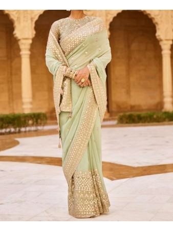 RE - Partywear pale green faux georgette embroidered saree